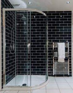 Black brick tiled wet room walk in shower