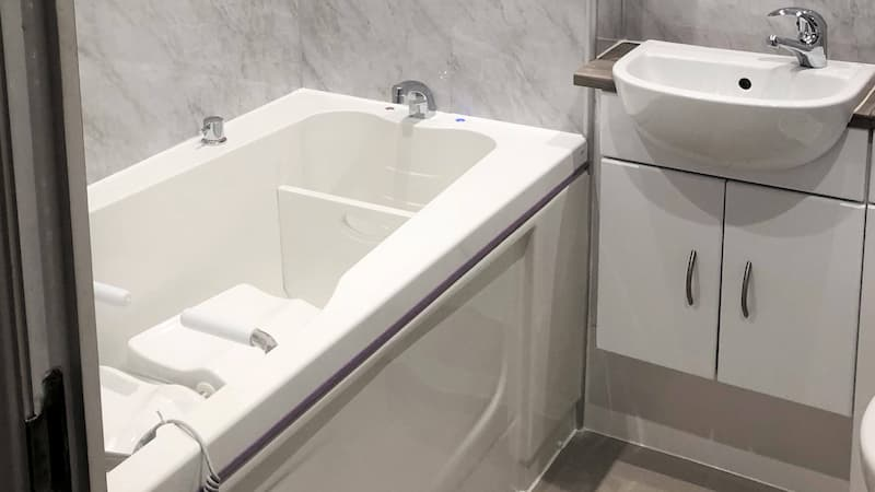 White bath with disabled seating assistance