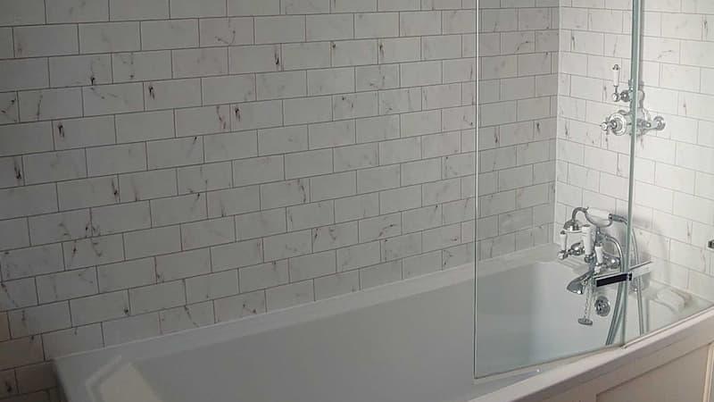 Dirty bathtub and wall with bath screen