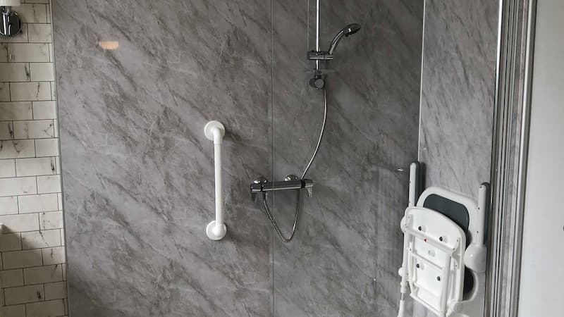 Shower with handrails and seat