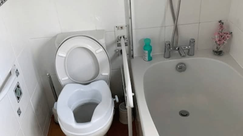 toilet with support rails, bath