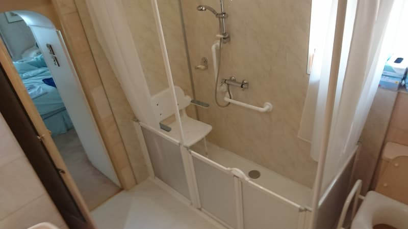 Walk in shower with seat and handrails