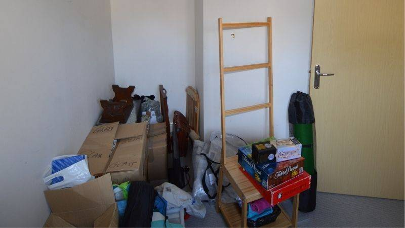 Room being used for random storage, full view